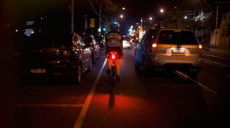 Riding bike at night with bicycle taillight.