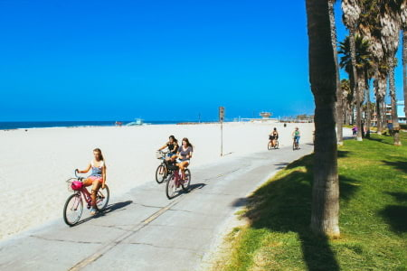 This is a picture of bike riders on the beach.