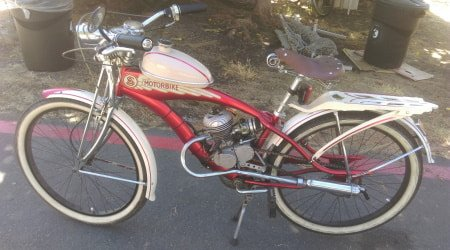Motorized bicycle with custom high-performance cylinder head.