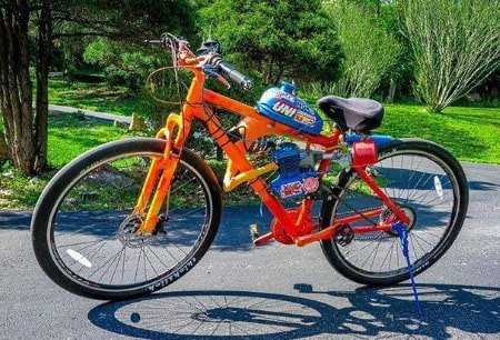 Customized motorized bicycle with a 2-stroke engine.
