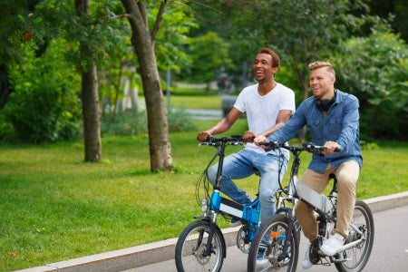 Socializing while riding electric bikes.