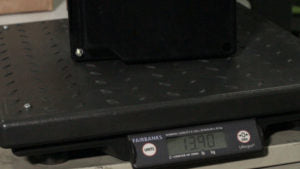 Lithium battery on scale displaying weight