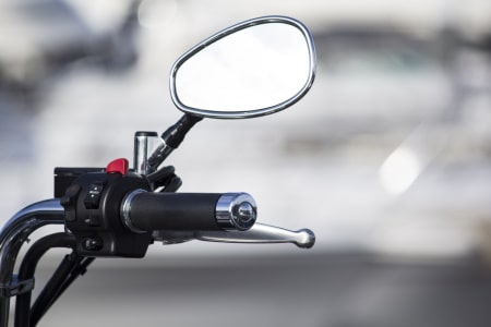 Rearview mirror on a motorized bicycle.