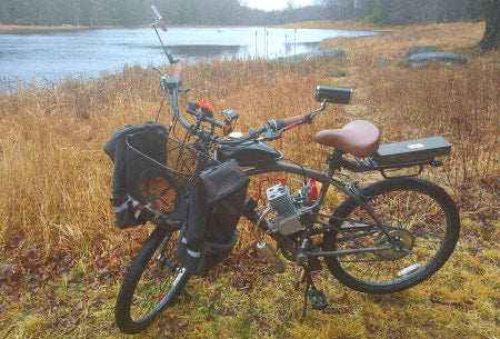 Off-road motorized bicycle with front cargo basket.