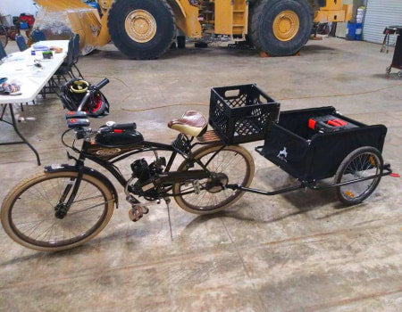2-stroke motorized bicycle with rear cargo trailer.