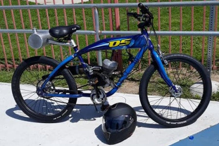 2-stroke motorized bicycle with rear gas tank.