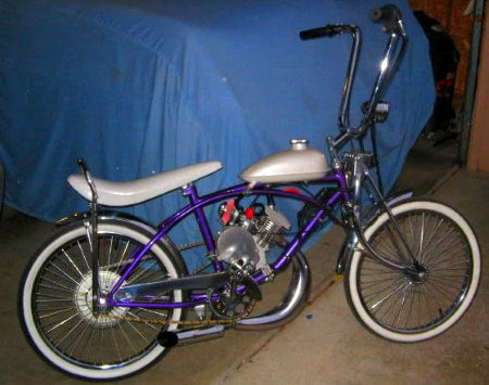 Motorized lowrider bicycle with horizontal muffler.