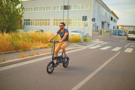 Riding an electric bike on the street.