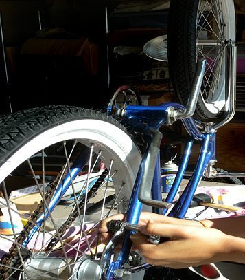 Motorized bicycle being worked on.