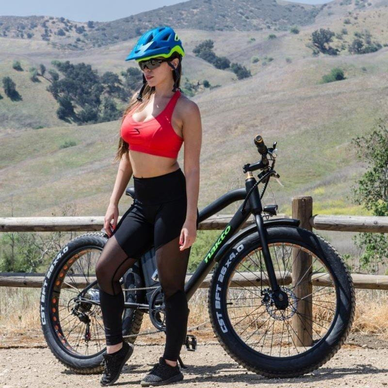 Nakto 300W Cruise Fat Tire Black - woman standing next to bicycle