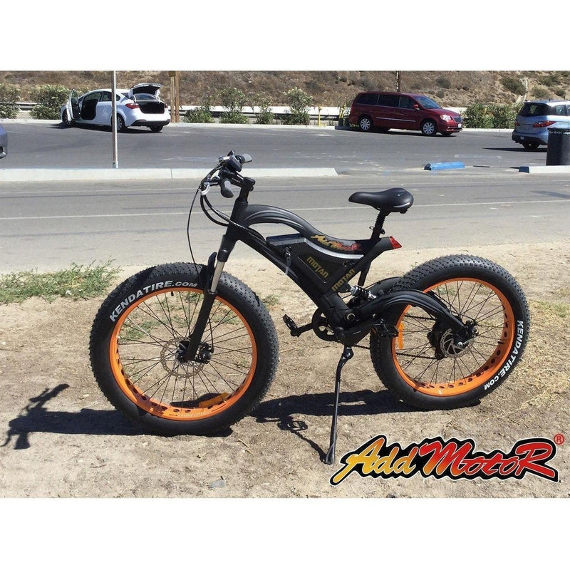 AddMotor 500W Motan M-850 Fat Tire bicycle parked on dirt