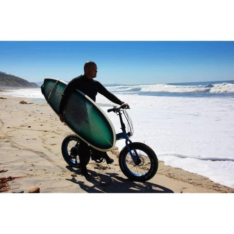 E-Mojo 500W Lynx Fat Tire man holding surfboard on bicycle
