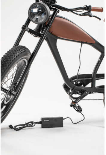 Civi 750W Cheetah Cafe Racer Fat Tire bicycle with charger plugged in