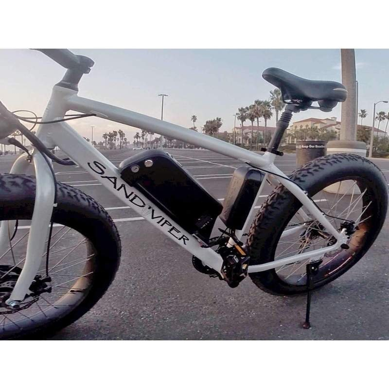 SSR Motorsports 350W & 500W Sand Viper Fat Tire Mountain white bicycle parked outside