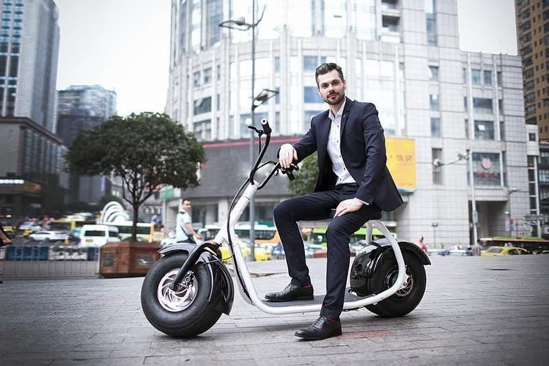 SSR Motorsports 800W SEEV-800 Fat Tire Electric Scooter - man sitting on scooter in city