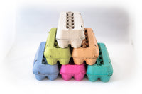 Image of 12 count colored cardboard paper pulp egg cartons in multiple colors with blank view tops.