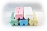Image of 12-count styrofoam egg cartons with flat blank tops and in multiple colors