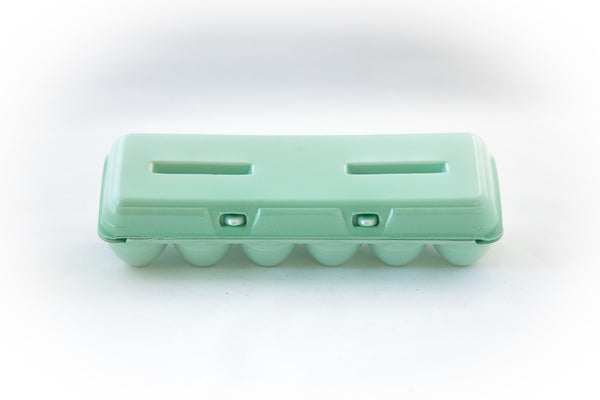 Image of a 12-count styrofoam egg carton with a blank flat top and in the color green.