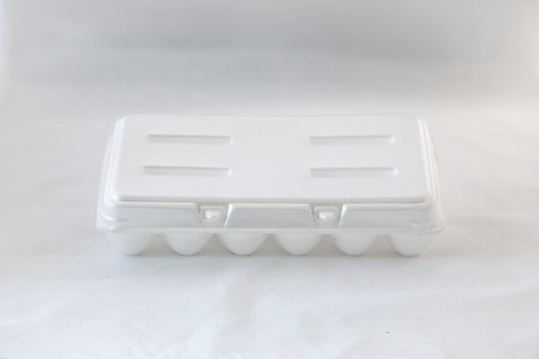 Image of an 18-count styrofoam egg carton with a blank flat top and in the color white.