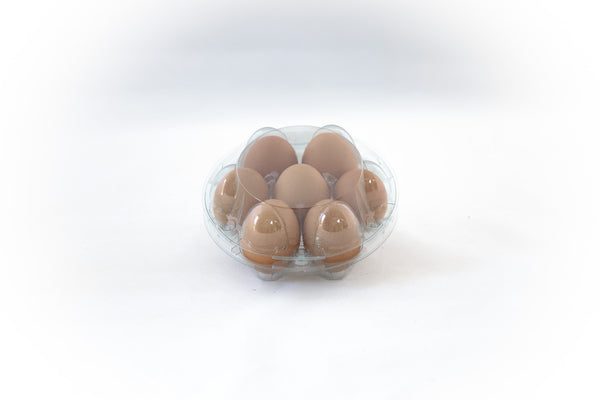 Image of a 7-count clear plastic egg carton in a round shape.