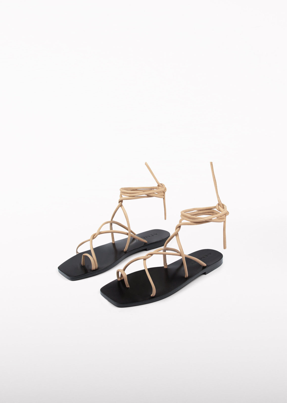 The Kinsley sandal gracefully folds over the foot and ties up the ankle. A toe hold securely keeps the foot in place. The ankle ties elevate a day or evening look.