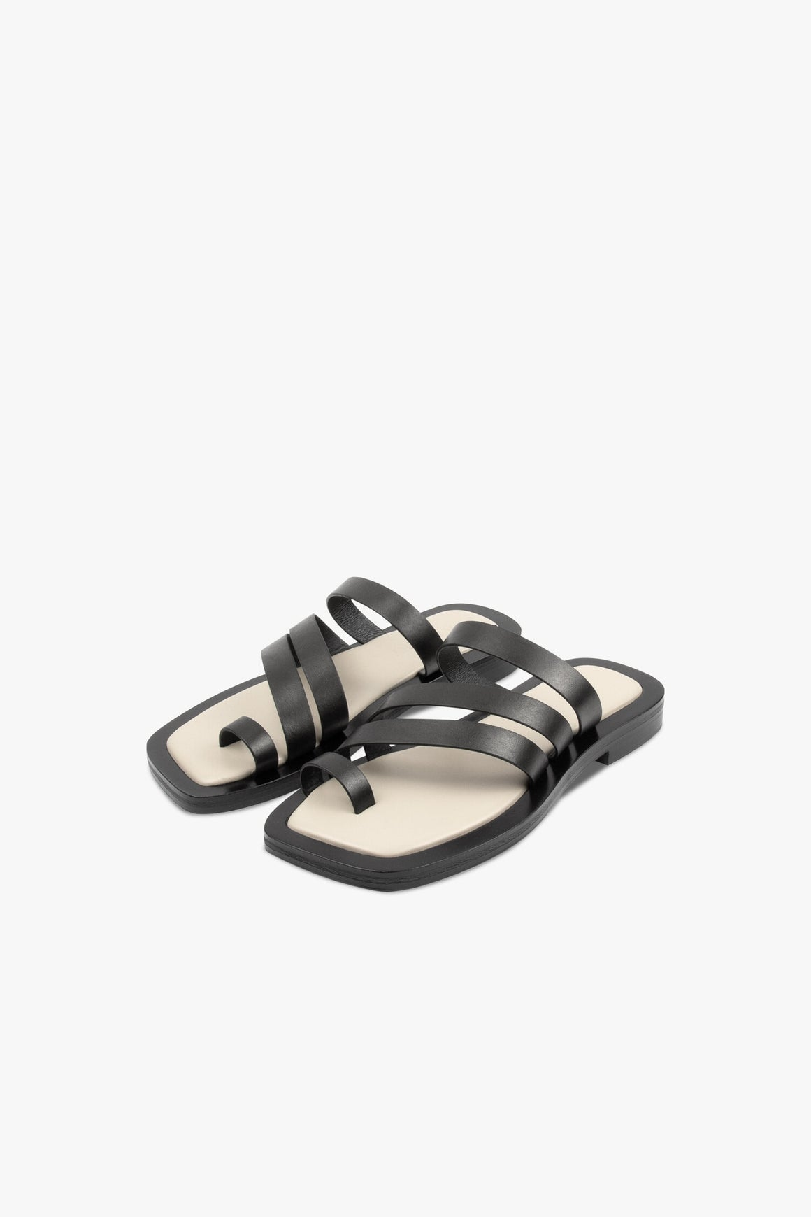 The Liam sandal features three thick straps that sit across the front of the foot. This slide style is grounded on our signature chunky footbed with black welt and contrast padded insole.