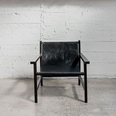 black leather sling arm chair