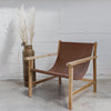 tan leather sling arm chair nz