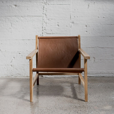 tan leather sling arm chair