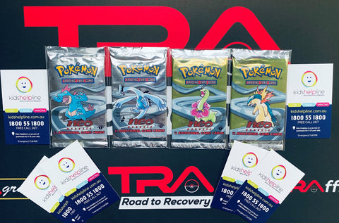 Pokemon Wizards of the Coast 1st Edition Neo Genesis Booster Packs Seasled, lugia, TRA road to recovery charity auction photo supporting kids helpline