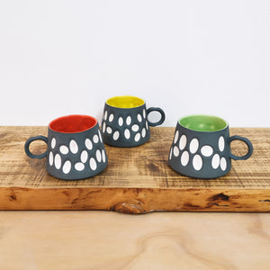 Charcoal Porcelain Mugs with glazed interior and carved exterior