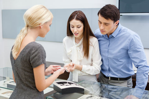 Couple choosing a wedding ring in store