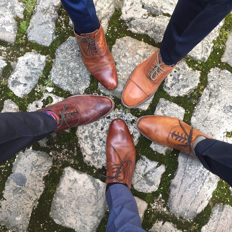 Men's legs and shoes in a circle