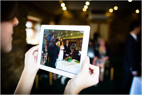 Watching a wedding on a tablet
