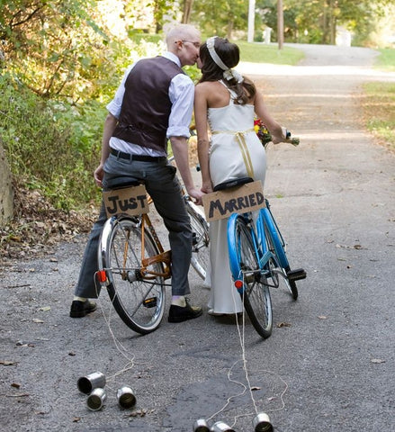 Bride and groom on bicycles