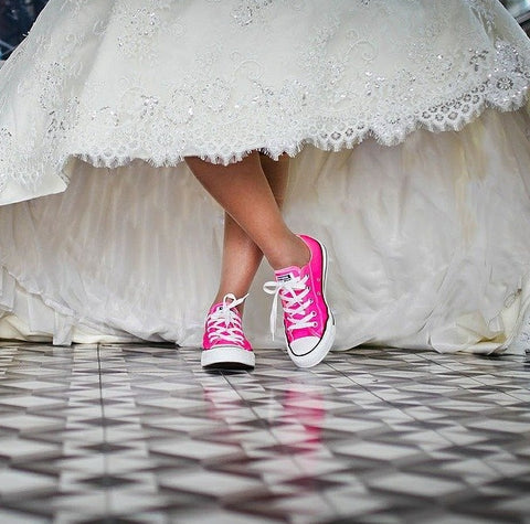 Bride wearing pink sneakers