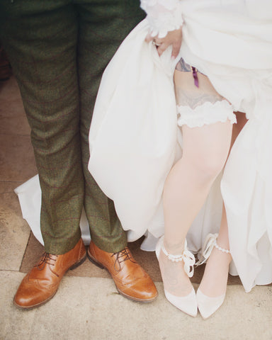 The happy couple's legs and feet