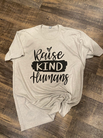 raise kind humans tee shirt | screen printing by the branded iron | Shop handmade apparel, homewares, gifts, & more at The Branded Iron. Or, contact us today for all your small business customization needs: tees, hats, cups, & more...we do it all. Proudly located in Boerne, Texas.