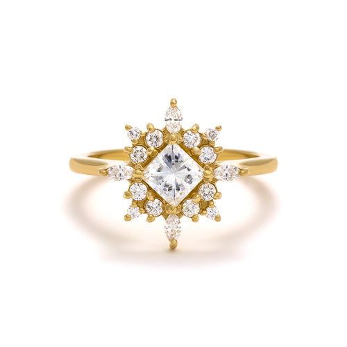 The Sophia Ring is made with a half carat princess cut diamond and accented with marquise and round diamonds.
