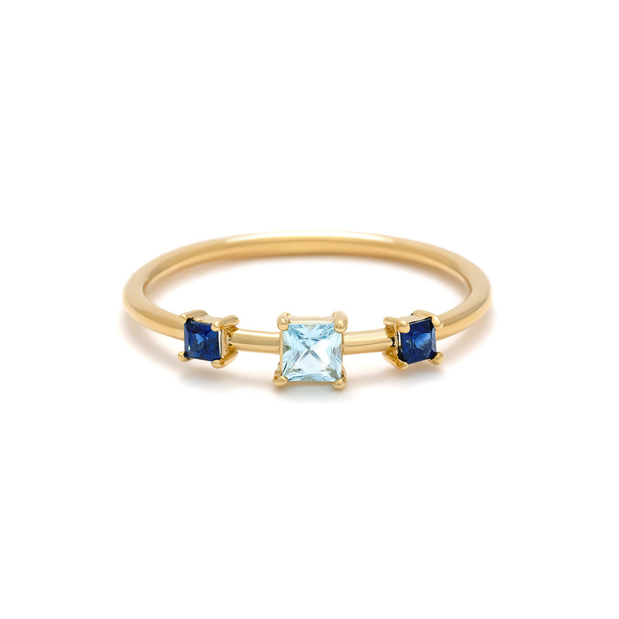 The Elizabeth Ring is made of 14 karat yellow gold and features 3 princess cut gemstones: two blue sapphires and an aquamarine.