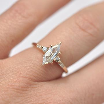 White hexagon shaped diamond on hand.