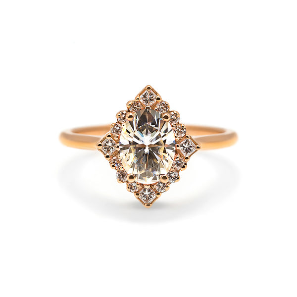 Marie Ring made in 14 karat rose gold and set with a 1.2ct oval diamond.