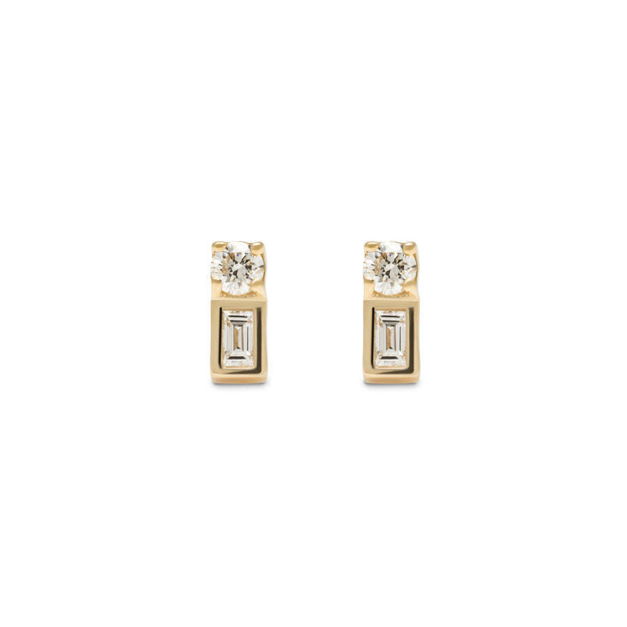 The Frida Earring is a small yellow gold earring made with a single round diamond and baguette diamond.