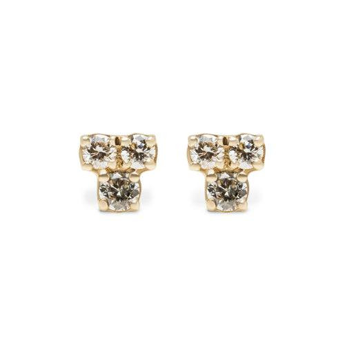 The Kimber Earring is made of 14 karat yellow gold and is set with 3 small round diamonds.