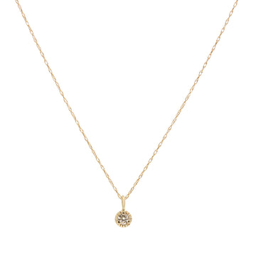 The Frances Necklace: a small pendant made of 14 karat yellow gold and set with a small diamond or moissanite.