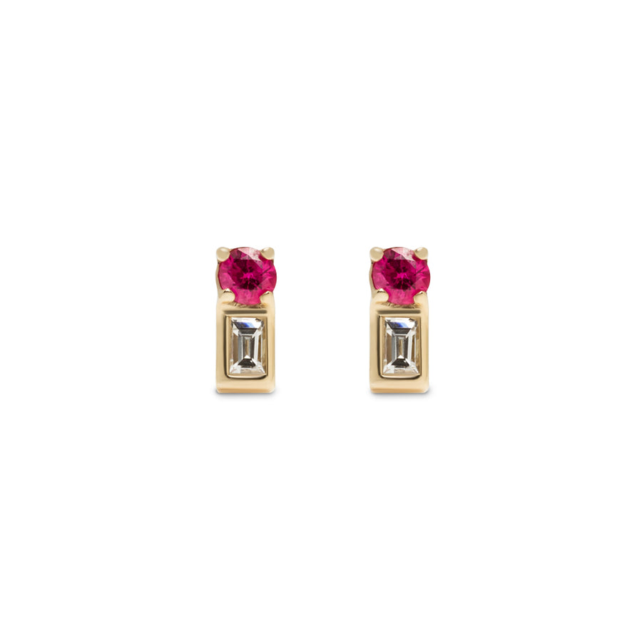The Ansley Earring is a small stud earring that features a round ruby and baguette diamond. It's made of 14 karat yellow gold.