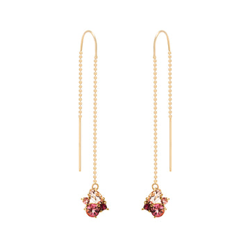 The Livia Earrings are made of red and pink colored gemstones (morganite, rubies, tourmaline and pink sapphire) and hang from beaded threader ear wire