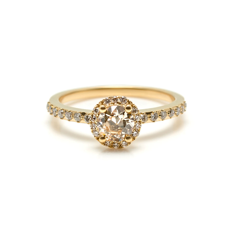 What makes the Maya engagement ring so special is an antique old european cut diamond which is surrounded by tiny white diamonds. On the band prongs are set at north, south, east and west for an updated look that adds even more sparkle.