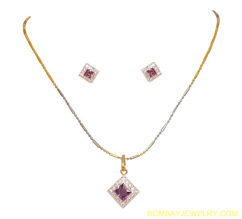 goldplated and silverplated purple and white diamond pendent set