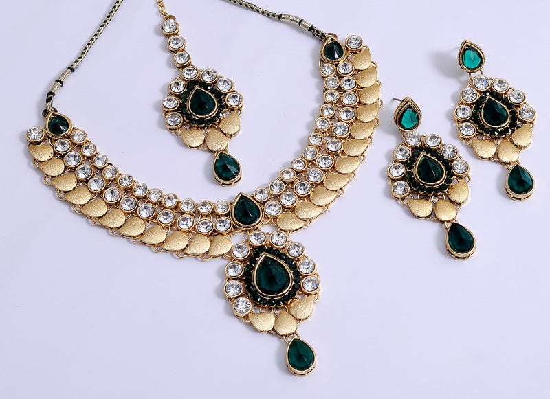 goldpolish dark green and white kundan set with tikka-40